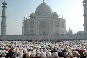 Muslims praying at the mosque at the famous Taj Mahal site in Agra, India