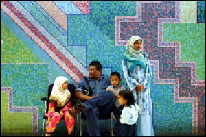A family in Kuala Lumpur, Malaysia, take a break from the Eid celebrations