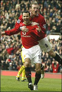 Giggs and Rooney celebrate United's opening goal