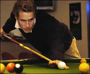 Right on cue -  when he's not studying the prince enjoys a game of pool with his friends