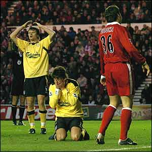 John Arne Riise (left) and Kewell are dejected as a chance goes begging