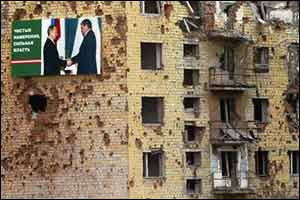 Election billboard in war-shattered Grozny, Chechnya  (Ilya Pitalev, Kommersant)
