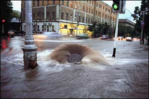 A water mains bursts after torrential rain, 2001 (Konstantin Krupenin/Kommersant).