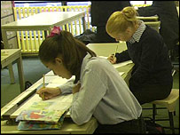 Children in a classroom studying.