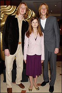 Harry Potter actors James and Oliver Phelps with Bonnie Wright