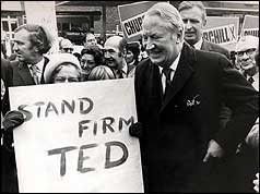 Edward Heath and campaigner holding stand firm Ted poster