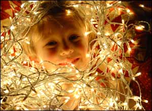 Boy and Christmas lights