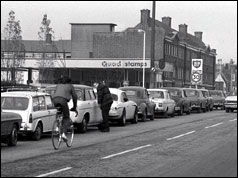 Queue of cars outside petrol station in London - 1973