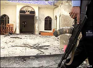 Iraqi policeman leaves the damaged mosque