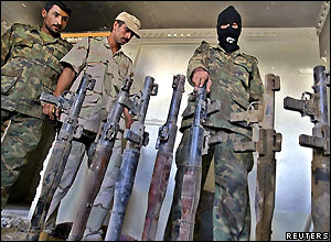 Iraqi soldiers and captured weapons