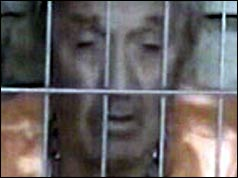 Ken Bigley behind bars