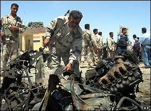 Police examine wreckage from Hawija attack