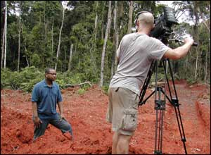 Lizo went to Cameroon, Nigeria and Ghana to film for Newsround. Here cameraman Rob sets up a shot