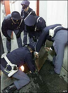 Police search a sewer