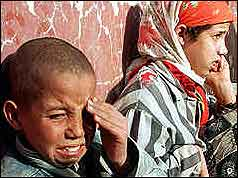 Distressed Algerian children following a massacre