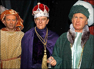 Waxwork models of British Prime Minister Tony Blair (left), The Duke of Edinburgh and President George Bush (right), dressed as the Three Wise Men
