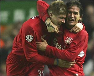 Neil Mellor is congratulated by his Australian team-mate Harry Kewell following his goal