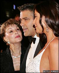 George Clooney (centre) with his mum (left) and Lisa Snowdon (right)