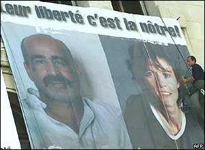 A poster of solidarity with former Iraqi captives Florence Aubenas and Hussein Hanoun al-Saadi