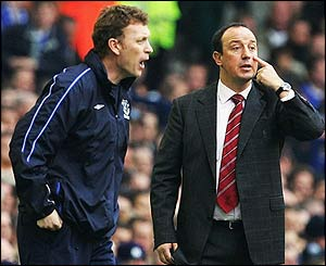 Everton boss David Moyes and his Liverpool counterpart Rafael Benitez urge on their players