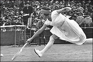 French player Suzanne Lenglen in action. Check out those socks!