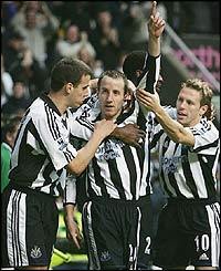 Newcastle's Lee Bowyer with teammates Steven Taylor and Craig Bellamy