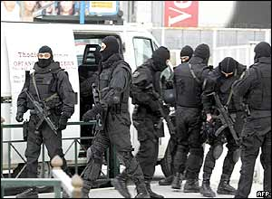 Heavily armed Greek special forces prepare to take up positions