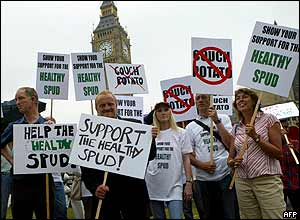 Campaigners in London holding placards saying 'Support the healthy spud'