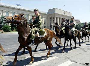 Mounted Kyrgyz police officers guard the government house in Bishkek