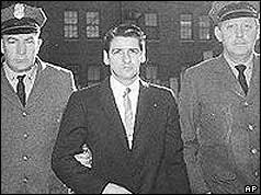 Albert DeSalvo flanked by two policeman