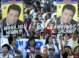 Supporters shout slogans during the funeral procession for former Philippine presidential candidate and action movie star Fernando Poe Jr. Wednesday, Dec. 22, 2004 in Manila.