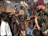 African children talk to a soldier