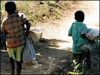 Children fetch and carry water
