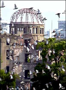 Doves fly over the Atomic Bomb Dome