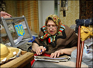 Elderly woman voting at home