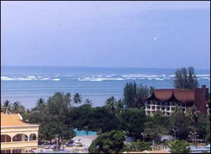 Waves hitting the north coast of Penang, Malaysia