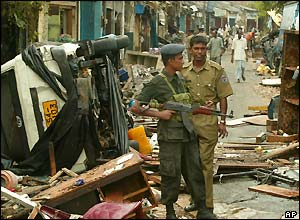 Sri Lankan troops patrol Galle in southern Sri Lanka, one of the worse areas hit by the sea surges