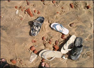 Flip-flops on the beach after the tsunami