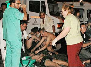Emergency workers attend to the injured outside a club in Buenos Aires, Argentina