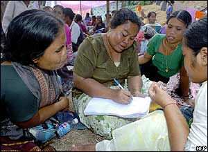 Villagers make up lists of the missing at a refugee camp in Port Blair, Andaman Islands