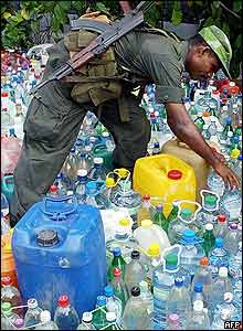 Sri Lankan soldier checks donated water