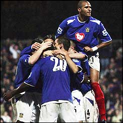 Aiyegbeni Yakubu is mobbed by his team mates after he scores an equalising penalty