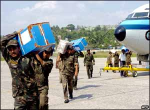 Indian army soldiers carry relief materials in the capital of Andaman and Nicobar Islands, Port Blair.