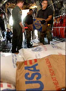 US Air Force soldiers load food water onto an aid flight bound for Banda Aceh, in Jakarta, Indonesia.