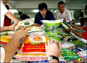 Malaysian Buddhist volunteers load food supplies at a temple in Kuala Lumpur.