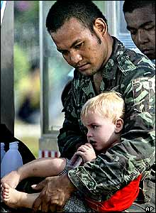 Thai soldier with child