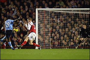 Shaun Wright-Phillips fires his shot past Phillipe Senderos and keeper Manuel Almunia