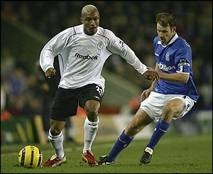 El Hadji Diouf evades the attentions of Birmingham's Kenny Cunningham