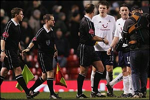 Tottenham's Michael Carrick and Robbie Keabe remonstrate with officials