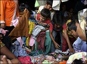 Refugees receive clothes in centre on the edge of Banda Aceh